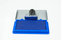 Rubber stamp and blue color inkpad Royalty Free Stock Images