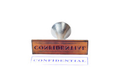 Rubber stamp confidential. On white background Royalty Free Stock Photos