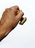 Rubber stamp in hand. Close up view of a hand holding an old rubber and wood stamp Stock Images