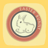 Rubber stamp for Happy Easter celebration. Stylish rubber stamp design decorated with Easter Bunny on yellow bakground Royalty Free Stock Images