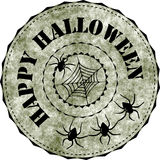 Rubber stamp: Happy Halloween. Grunge Halloween rubber stamp with spiders Royalty Free Stock Photos