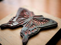 Rubber Stamp of Butterfly on Wooden Desk for Arts and Crafts royalty free stock photography