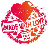 Rubber stamp made with love. And heart Stock Photo