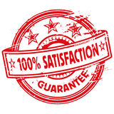 Rubber stamp one hundred percent satisfaction Royalty Free Stock Photography
