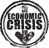 Rubber stamp with the text economic crisis. Abstract black grunge rubber stamp with the text economic crisis written inside the stamp Stock Photography