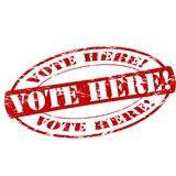 Vote here. Rubber stamp with text vote here inside,  illustration Stock Photo