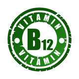 Rubber stamp with vitamin B12. Green round rubber stamp with vitamin B12 Royalty Free Stock Photos