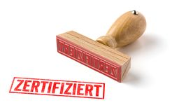A rubber stamp on a white background - Zertifiziert German word royalty free stock photography