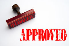 Rubber stamp with the word APPROVED Royalty Free Stock Images