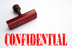 Rubber stamp with the word CONFIDENTIAL Stock Photos