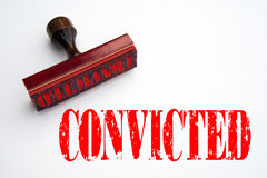 Rubber stamp with the word CONVICTED. Rendering of a rubber stamp with the word CONVICTED in red ink Stock Photos