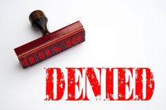 Rubber stamp with the word DENIED Royalty Free Stock Photo