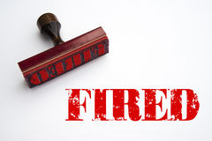 Rubber stamp with the word FIRED. Rendering of a rubber stamp with the word FIRED in red ink Stock Image