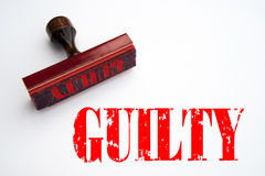 Rubber stamp with the word GUILTY. Rendering of a rubber stamp with the word GUILTY in red ink Stock Photo