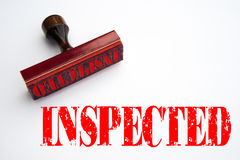 Rubber stamp with the word INSPECTED Royalty Free Stock Photos