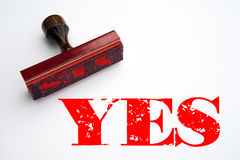 Rubber stamp with the word YES. Rendering of a rubber stamp with the word YES in red ink Royalty Free Stock Photography