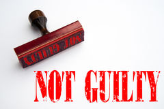Rubber stamp with the words NOT GUILTY. Rendering of a rubber stamp with the words NOT GUILTY in red ink Royalty Free Stock Images