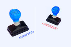 Rubber stamper with the word APPROVED and CANCELLED. Printed in red Stock Image