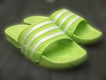 Rubber stripe slippers. On wooden background royalty free stock image