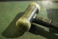 Rubber tip hammer, blurred background, work room stock image