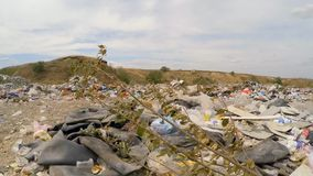 Rubber Tires Among Garbage Dumped Into Heap At stock video footage
