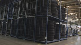 rubber tires on shelves at producing workshop territory produced rubber tires stored on two level shelves and huge producing stock video