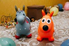 Rubber toy donkey. On playground stock photos