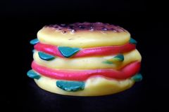 Rubber toy hamburger. royalty free stock photography
