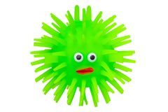 Rubber toys. Funny green puffer fish made of rubber. Cute toy fish isolated on a white background. Macro stock photo