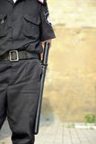 Rubber truncheon on the belt of security employee Stock Photography