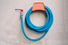 Rubber tube. Blue hanging on the wall old Stock Photography
