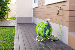 Rubber tube and hose. The rubber tube with hose set preparing for water the yard and the plants stock image