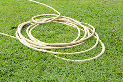 Rubber water tube on the grass Royalty Free Stock Image