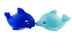 Rubber whale and dolphin. Bath toys, blue orca and turquoise dolphin Stock Image