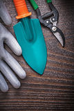 Rubber working glove hand spade and secateurs on vintage wooden Stock Photos