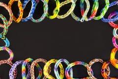 Rubberarmbanden als achtergrond Stock Afbeeldingen
