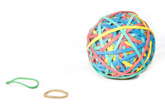 Rubberband ball. A multi colored rubber band ball on a white surface Stock Photo