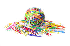 Rubberband Ball and Paper Clips. On White Background Stock Photos