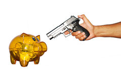 Rubbery. Piggy bank and hand with gun isolated on white background Stock Photography