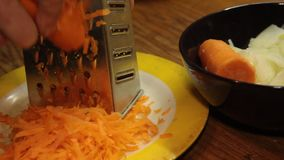Rubbing carrots on a grater stock video footage