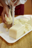 Rubbing cheese a Stock Image