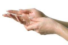 Rubbing In Hand Lotion Royalty Free Stock Photo