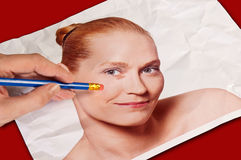 Rubbing out wrinkles on photo Stock Image