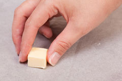 Rubbing paper with butter Royalty Free Stock Image