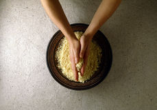 Rubbing the semolina with hands. Food, gastronomy, cooking,cookery Royalty Free Stock Image