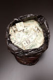 Rubbish bag with dollars Stock Photography