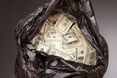 Rubbish bag with dollars. A Rubbish bag full of dollars Royalty Free Stock Images