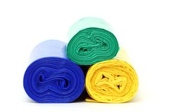 Rubbish bags rolls. On white Stock Images