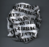 Rubbish Ball. Screwed up ball of waste paper with text visible Stock Images