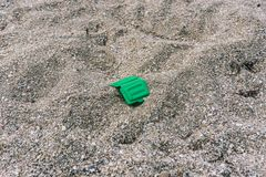 Rubbish on the beach. Ecological problem. Dirty sea. Sandy seashore royalty free stock photos